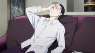 Yut-Lung looks over at the newspaper