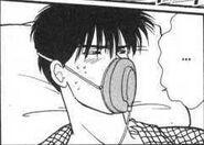 Eiji wears a oxygen mask