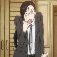 Yut-Lung pulls his eyelid down and sticks his tongue out at Blanca