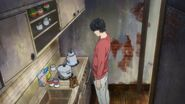 Eiji watches the food being cooked