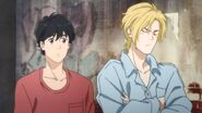 Ash crosses his arms while Eiji becomes confused