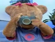 Amy holding a camera
