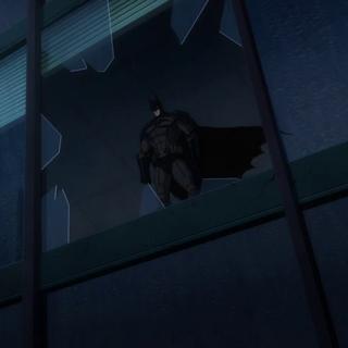 Batman observa la