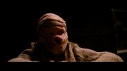 Bane luego de haber sido herido por loss prisioneros.