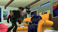 Batman playing Nintendo Wii