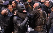 Bane-Batman in a headlock