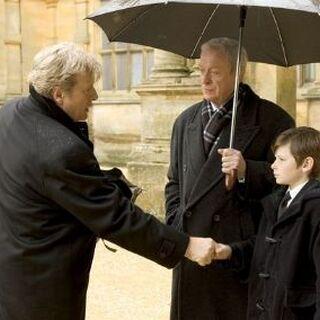 Alfred junto a Bruce tras el fallecimiento de sus padres