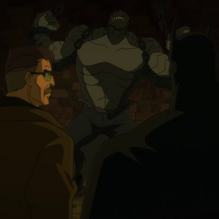 Gordon y Batman visitan a Killer Croc.