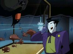 Joker talking to Batman