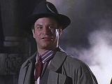 Alexander Knox (Robert Wuhl)