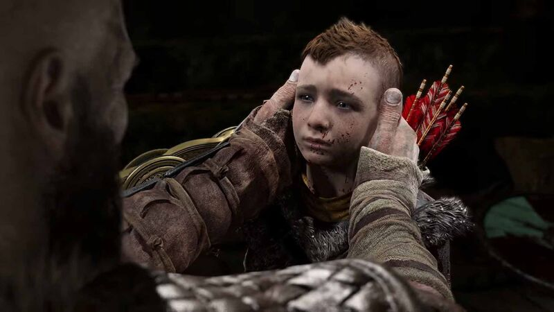 Kratos holds Atreus' head gently