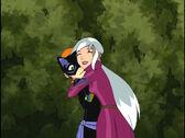 Charmcaster abraza a Gwen