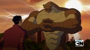 Humungosaurio manos unidas viendo a Rex