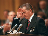 Ceausescu shields his eyes