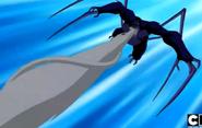 561px-Mono Araña Supremo lanzanod telaraña de su boca