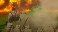 Gólems protegiendo a Guts (anime 2016)