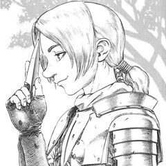 Judeau holds a knife to his forehead.