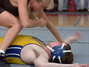 Elly May grabs Derek's arm after pinning him