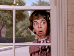 S1E2 Colorized - Gladys peeking through window