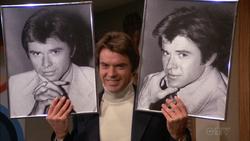Tab E1 - Paul holding photos of himself