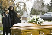 Motherandchildrenatfuneral-GettyImages-104302941-5a446aa89802070037db0f21