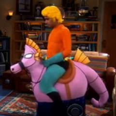 Raj dressed as Aquaman riding his seahorse.