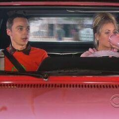 Penny chauffeuring Sheldon.
