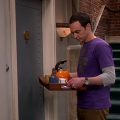 Sheldon can't knock, his hands are full.