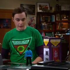 Sheldon looks at his Spock figure.