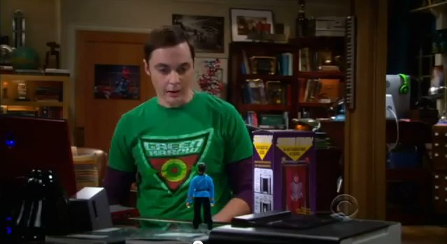 File:S5EP20 - Sheldon looking at his Spock doll.jpg