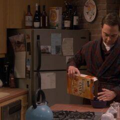 Sheldon fixing breakfast.