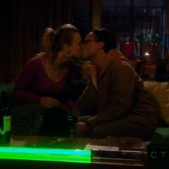 Leonard and Penny kiss during the blackout at the apartment.