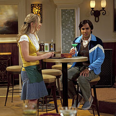 Raj drinking and talking to Penny.