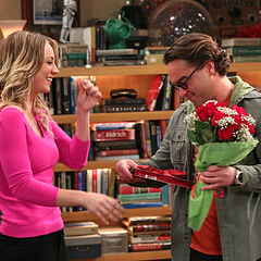 Penny gives Leonard flowers and candy for Valentine's Day.