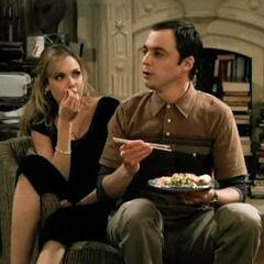 Katie picking at Sheldon's food.