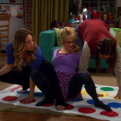 Penny, Amy, and Bernadette playing <i>Travel Twister</i>.