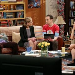 Sheldon showing pictures of his first college graduation.