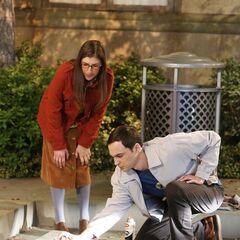 Amy is helping Sheldon reclaim his spot.