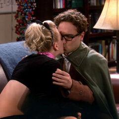 Penny kisses Leonard.