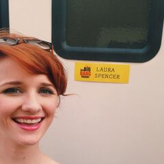 Laura in front of her trailer.