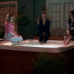 The girls dipping their feet in the hot tub.