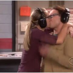 Leonard and Penny kiss at the shooting range.