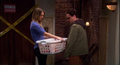 Penny and Leonard meet in the hallway.png