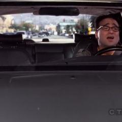 Leonard singing in the car.