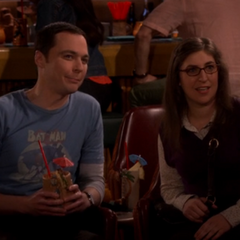 Sheldon and Amy listening.