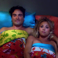 Leonard and Penny in bed together.