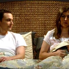 Amy getting into bed with Sheldon nervously.