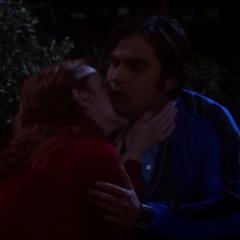 Emily kissing Raj.