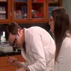 Sheldon working with Amy.