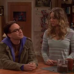 Leonard and Penny having a conversation with Sheldon.